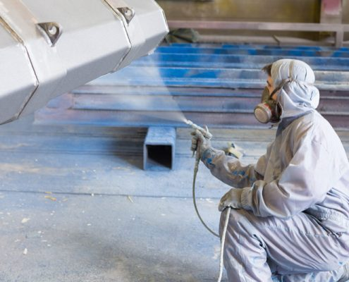 abrasion resistant coating being applied on steel