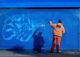 removing graffiti from a surface with anti graffiti coating