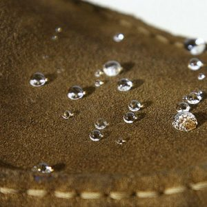 hydrophobic coating on a shoe with water drops