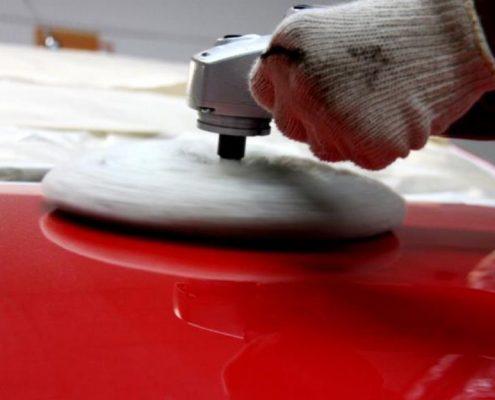 Polishing a car where teflon coating has been applied onto