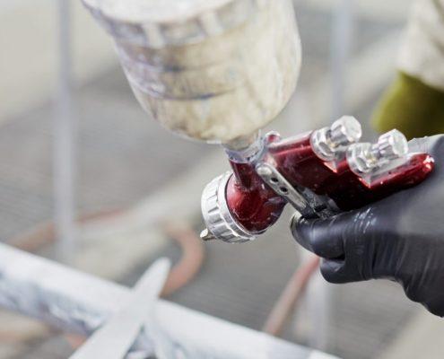 applying heat resistant paint with spray gun