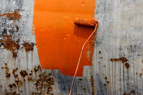 rolling orange liquid coating on wall