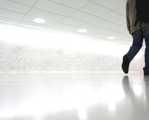 man walking on white 3d flooring in India