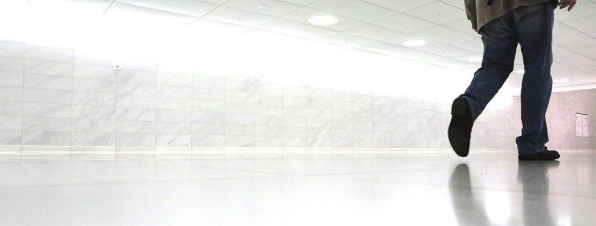 man walking on white 3d flooring in India